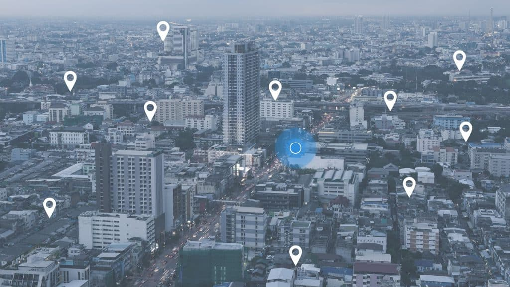 Searching,Location,On,Map,And,Pin,Above,Blue,Tone,City