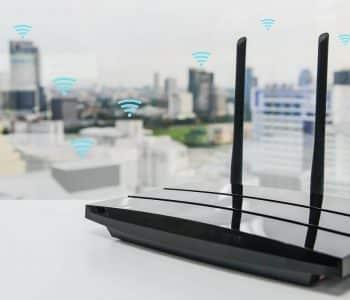 Black,Three,Poles,Wifi,Router,On,The,White,Table