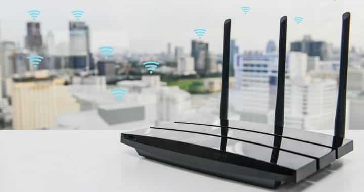 Black,Three,Poles,Wifi,Router,On,The,White,Table